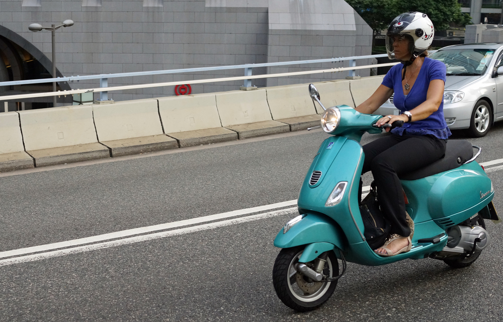 One cool lady on a scooter - wow!