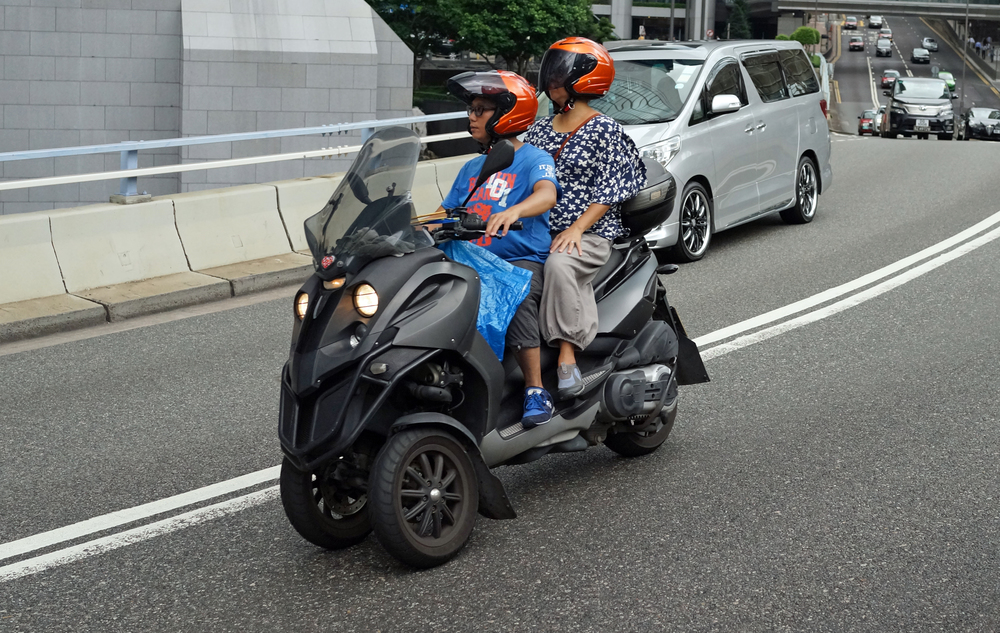 Looks like Hubby and Wife have traded up from spandex and a bicycle to one of those weird 3 wheel scooters - not the coolest couple in Hong Kong.