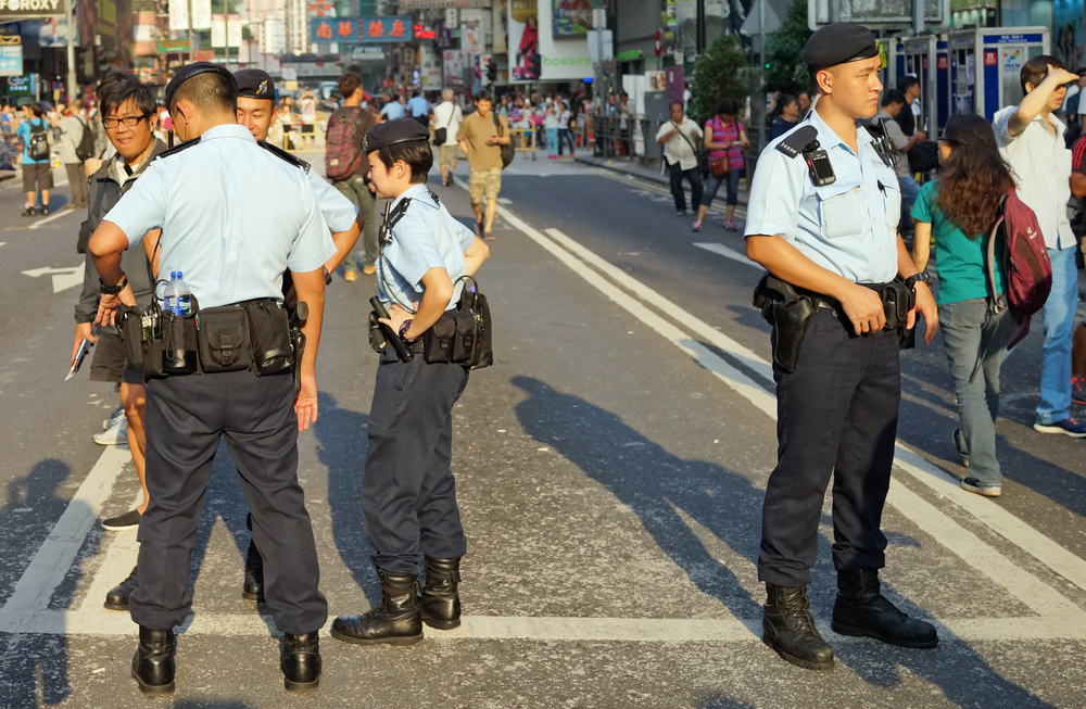 The Police Tactical Unit or PTU patrolling at the the Mongkok site of the Student Protests.