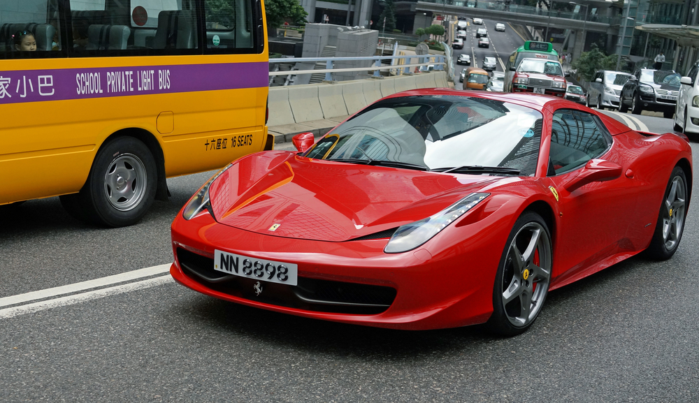 Look very carefully at the little girl on the school buy staring wistfully at this rather gorgeous Ferrari - love at first sight!