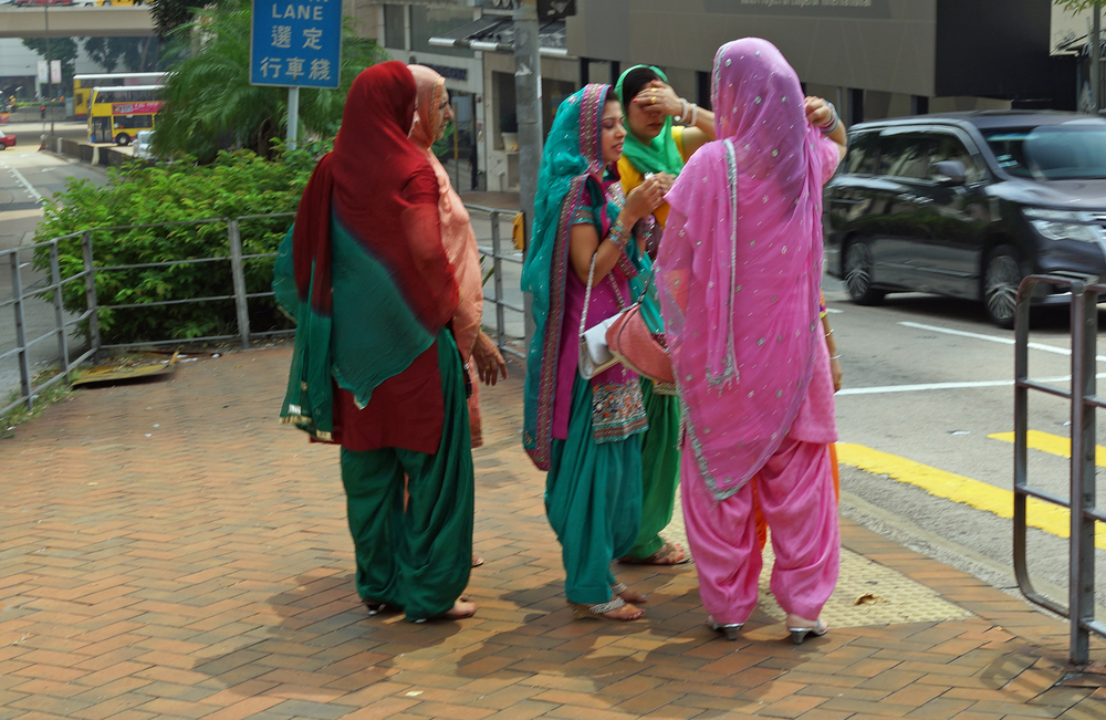 A group of Sikh ladies having a good gossip before crossing the road to visit the Sikh Temple in Wanchai