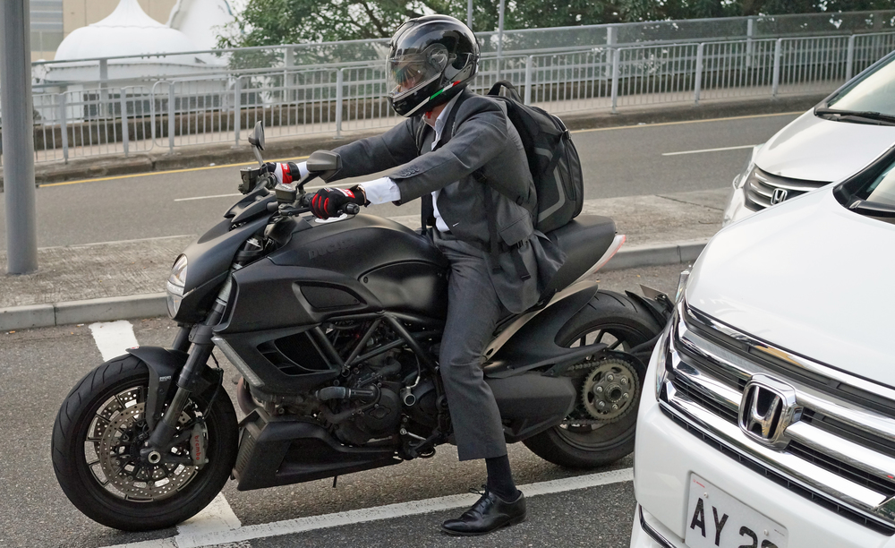 I really admire this suit riding this awe inspiring Ducati - uber cool!! the bike has a very futuristic look about it and goes like the clappers.