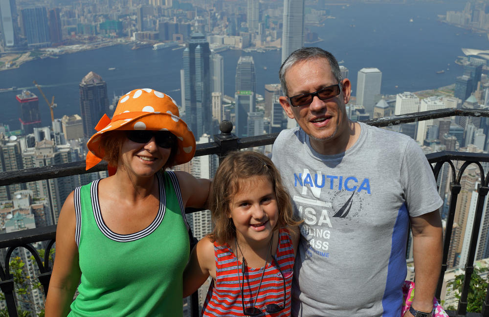 Zsuzsanna + Laszlo + Laura enjoying the magnificent views from my spot at Victoria Peak in Hong Kong.
