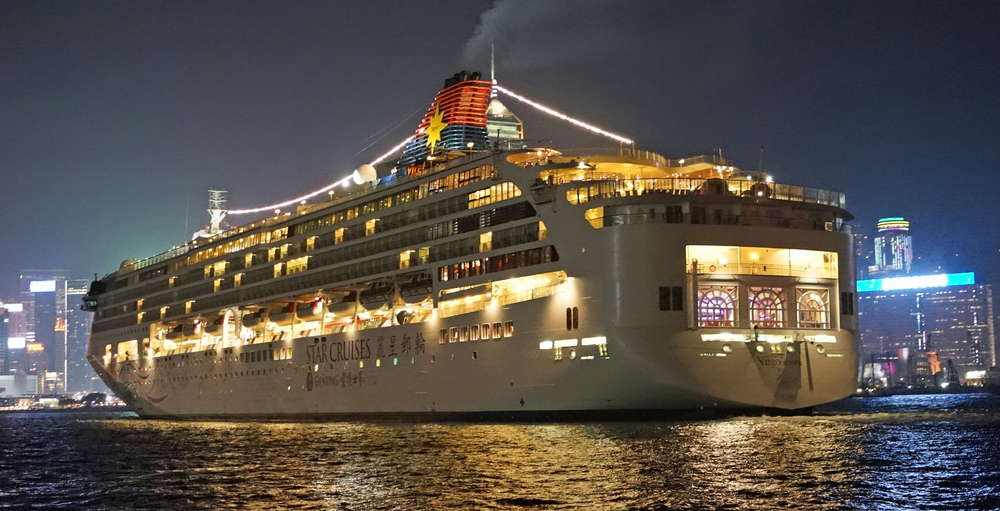 The Superstar Virgo sailing out of Hong Kong on October 20th 2014 - pity the clown wasn't on board.