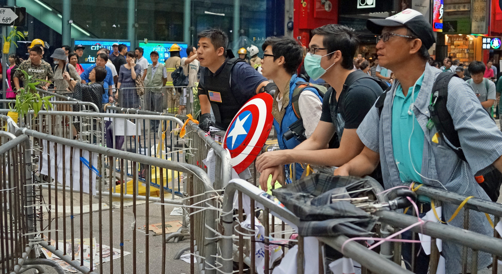 For the life of me I cannot understand why our Government does not clear these people and their stupid barricades - would you want your future decided by a moron carrying a Captain America shield?