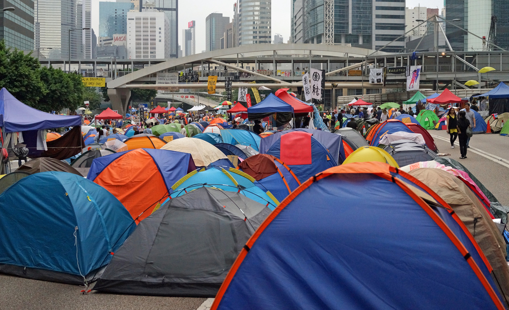 "See comment above - this is   the major road   on Hong Kong Island, still blocked after 4 weeks, why does our Government tolerate this?? oh - most of the tents are empty and the place is like a big garbage dump - it is only a matter of time before the ""students"" start building concrete structures on the road."