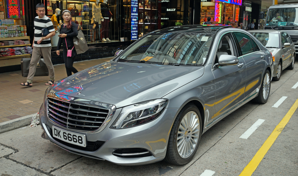 A Mainland Chinese couple admire a US$250,000 Mercedes Benz in TST, Kowloon - lovely car and a very lucky number plate that denotes a very easy life and wealth.  Go here for all my car number plate images