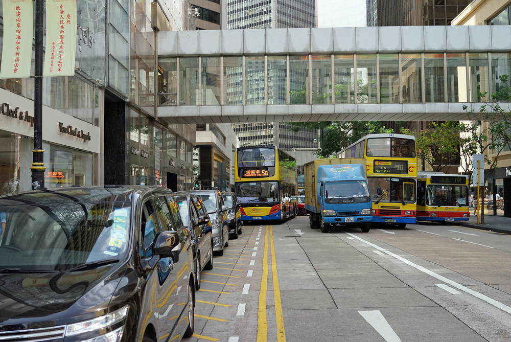 Chater Road in Central, a very busy road. The Japanese 7 seaters on the left are chauffeur driven 2nd cars of our rich folk and park illegally here every day. The truck and the 2 buses to the right collided and blocked traffic. The bus on the left could not pass because of the illegally parked cars. The chauffeurs refused to move their vehicles - it would appear they fear their rich bosses more than an angry mob of frustrated drivers. It took 10 minutes and Police intervention before the cars moved... only in Hong Kong