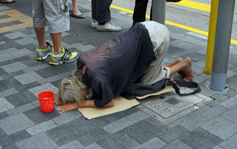 A professional beggar on the streets of Kowloon