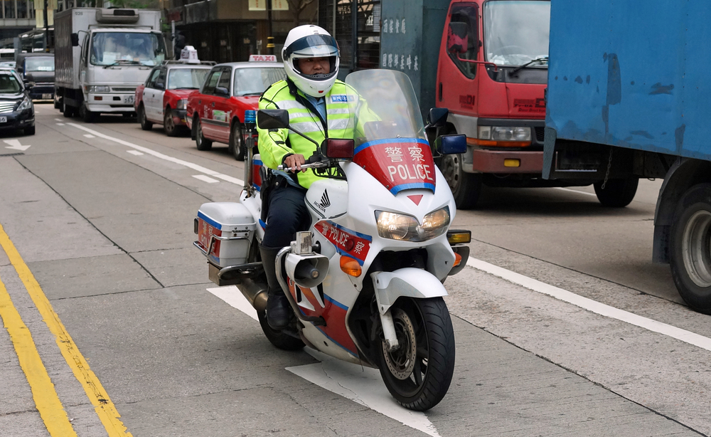 A traffic cop doing his thing in Central -  Go here for all my Police images