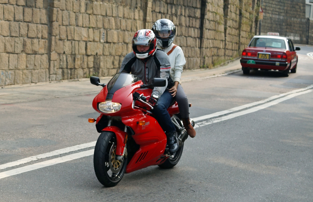 Me getting the evil eye from these youngsters on a fabulous bike, the Ducati -  Go here for all my motorbike images.