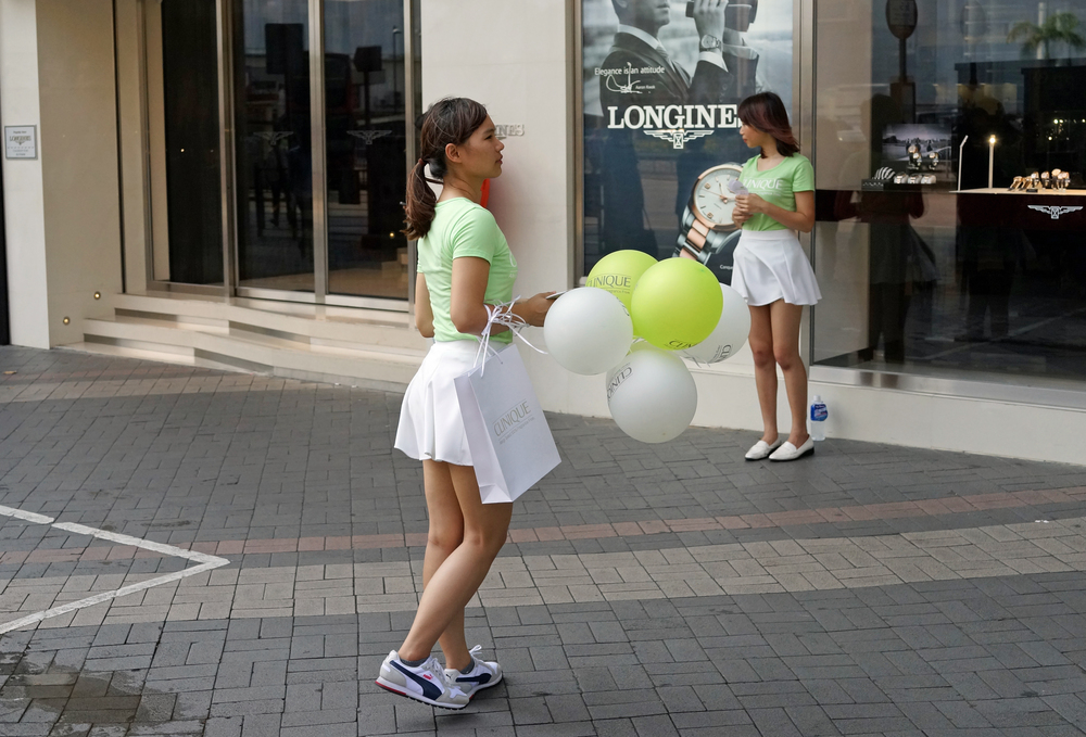 Hong Kong companies learn fast - cute girls and balloons sell products and services