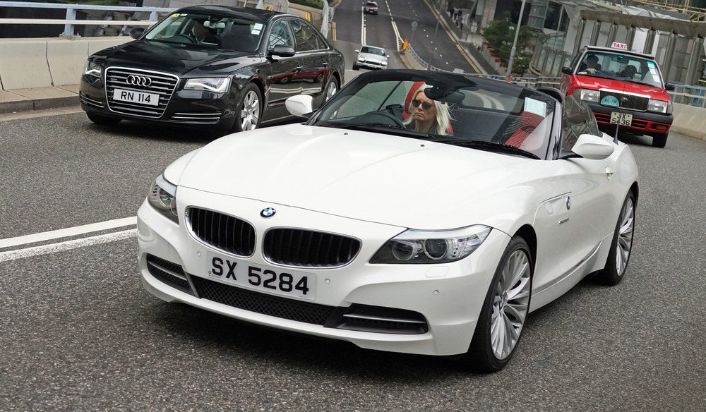 That is one sad blonde, if I owned a nice BMW like this I would be grinning from ear to ear!