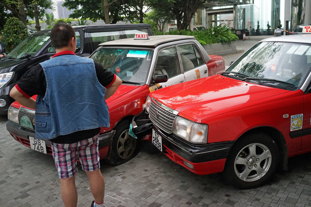 Fender benders involving taxi's are pretty common in Hong Kong, although I am scratching my head as to how these cabs managed to collide at the entrance to the Upper House Hotel??