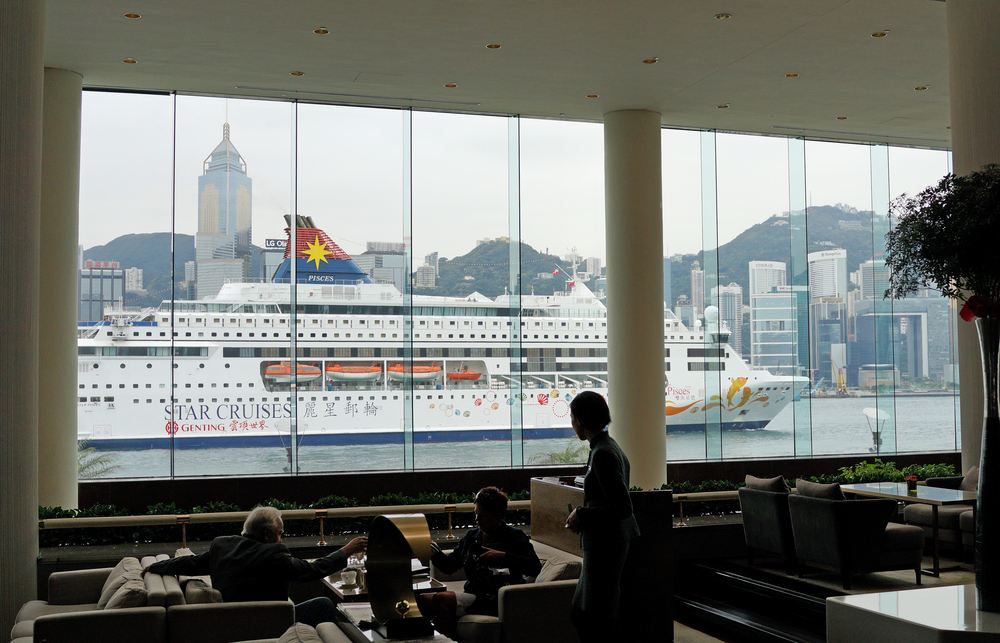 A bit of an iconic image - the Star Pisces gambling ship sailing past the Intercontinental Hotel -  go here for all my Star Cruises images