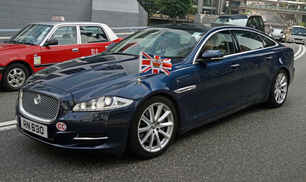Finally, there are always a couple of cars which I dream of taking a picture of and this was at the top of my list, the official car of the British Consul General flying the flag - I have gotten a lot of images of the car but never once with the flag flying. Bingo!