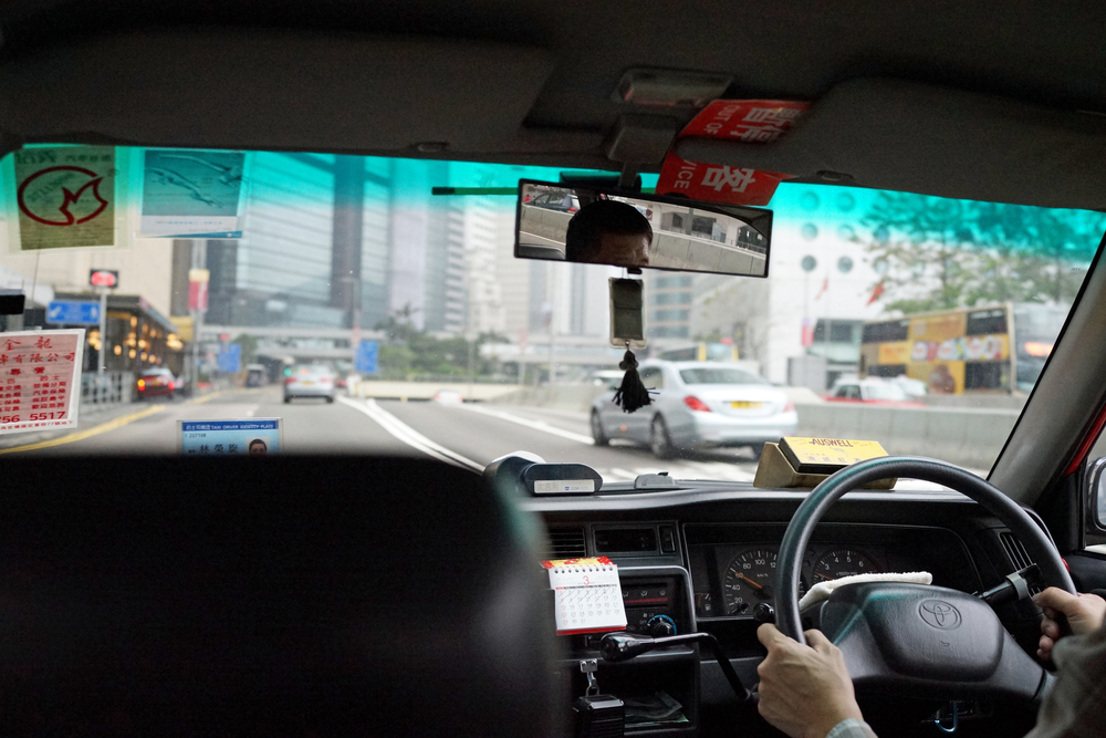 The interior of your atypical Hong Kong Taxi, the Toyota Crown...