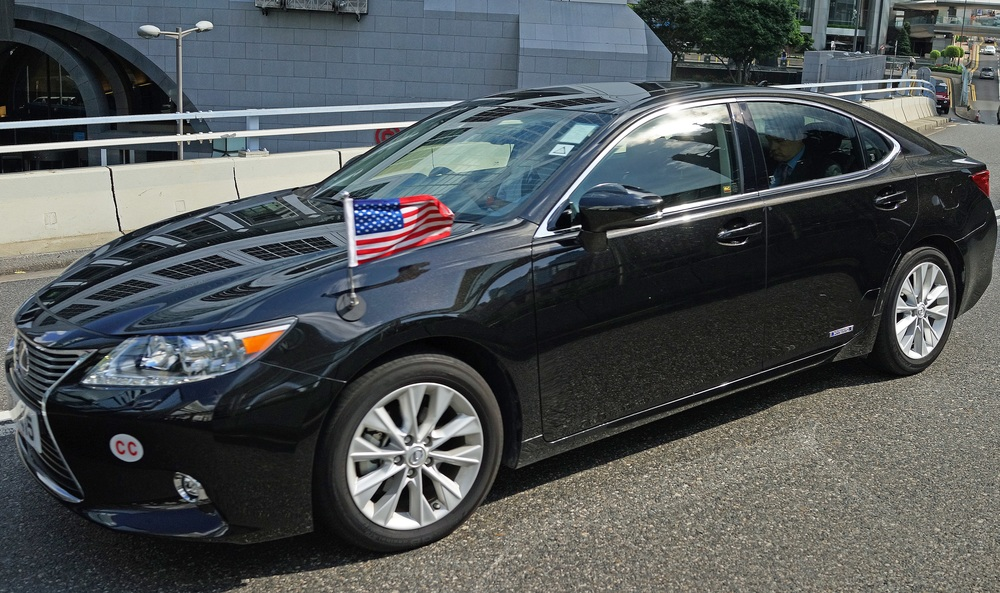 The US Consulate operates BMW's and Lexus's, as much as I love the flag on the hood, it would be more fitting if the car was an American car such as the Tesla! -