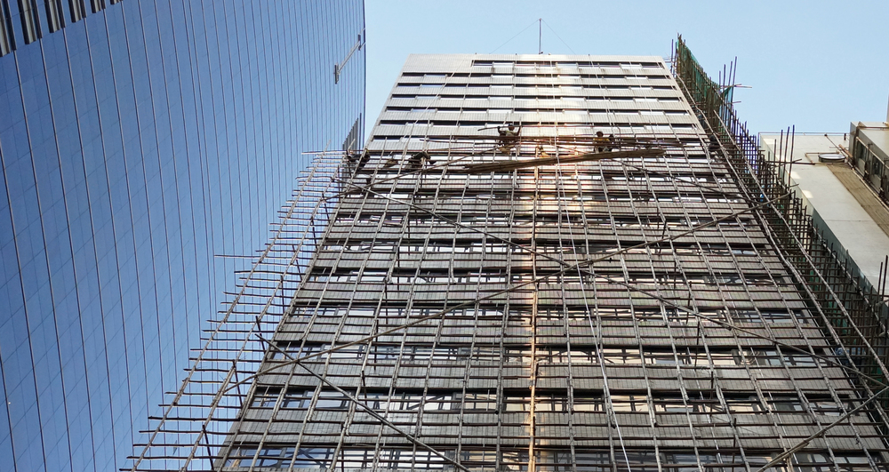 "These guys are fearless, the bamboo scaffolding guys! they wear safety equipment but do not actually hook themselves ""in"" - it's a long way down."
