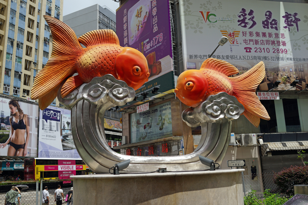 "The goldfish statue gives a hint that the Goldfish Market lurks nearby on Fa Yuen Street, I often think that using the term ""market"" for this place is just plain wrong, essentially it is a street with a small bunch of shops selling goldfish and other fish along with supplies.  Over the years a lot of the pet fish stores have gone the way of the dinosaur to be replaced by regular pet stores selling dogs, cats, rabbits and assorted reptiles, you can basically walk the ""market"" in under 8 minutes so I do not think it is worth a trip unless you are in the area. -  go here for all of my images of the Goldfish Market"