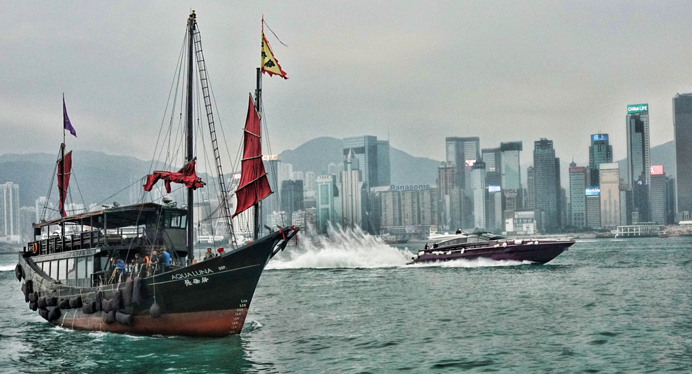 The rather lovely Aqua Luna that potters around Hong Kong harbour day and night being blown off by a rather nice speedboat.... -  go here for all of my Aqua Luna images