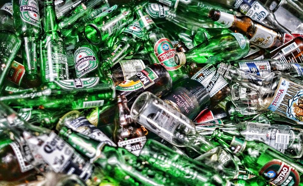 A bin full of bottles, beer and spirits -
