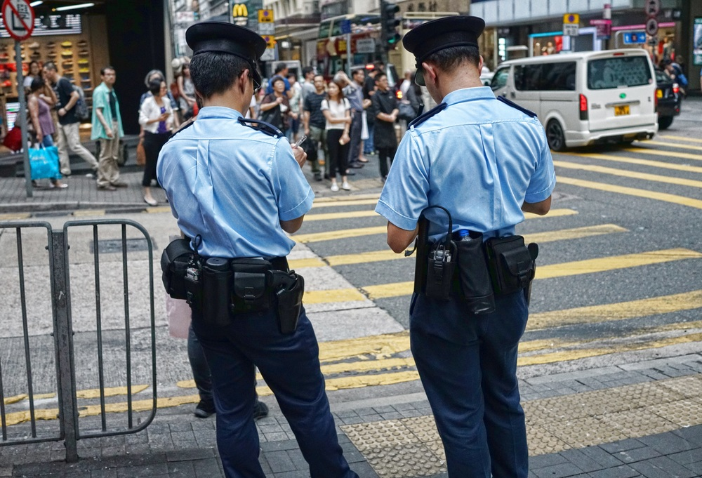 Two patrolling Policemen in Hong Kong and a very fine lot they are.