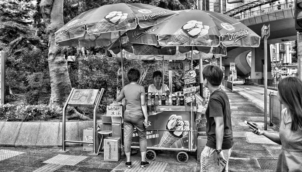 I do a lot of car photography on the bridge (top right of this image) so I always stop and get my Coke Zero from this friendly street vendor in Chater Garden in Central. -  go here for all of my favourite Hong Kong images
