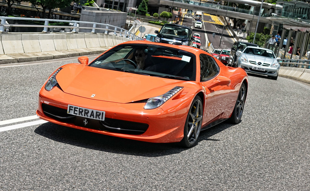 This is a very rare red/orange Ferrari, I also like the reminder on the number plate!