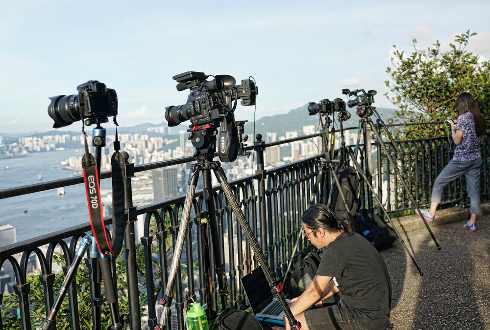 Keeping up with the Joneses is more than alive and well in Hong Kong even with camera's - here are a bunch of amateur enthusiasts comparing equipment size at my spot at the Peak.. quite funny actually..   Go here for all of my Peak images
