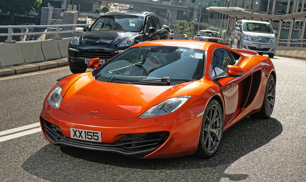 I have been photographing this amazing burnt orange McLaren for a couple of years now, the drive always has a toot of the horn, smile and a wave for me.. I love this car.   Go here for all of my McLaren cars in Hong Kong images
