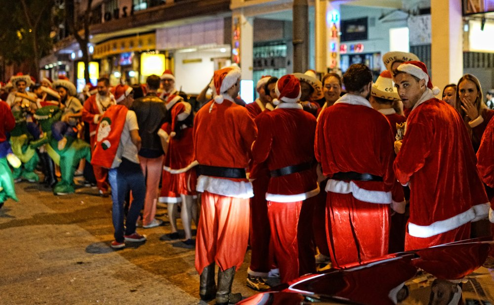 Yep, that's me getting the evil eye from an evil Santa, well a drunken Santa at the very least, throughout today (December 10th 2016) on tour we saw hundred's of drunken Santa's roaming the streets of Hong Kong... something to do with an event called SantaCon.... well, whatever makes you happy and they all congregated on the somewhat seedy Lockhart Road in Wanchai by the girlie bars. -  go here for all of my SantaCon 2016 images