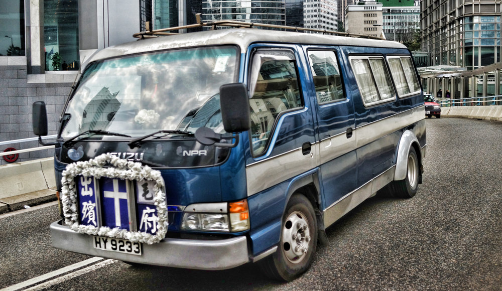 The typical Hong Kong hearse - every now and then you see a more US style hearse but this design is still the common one in Hong Kong, it is quite an odd looking vehicle.  - go here for all of my Hong Kong hearse images