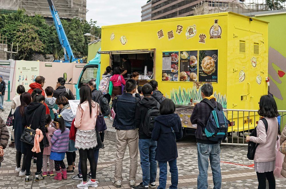 This is one of the new 16 food trucks that hit Hong Kong streets in early February 2017...the entire project (2 years from approval to rolling out onto the streets) was a Government project whose minions oversaw every single aspect from truck design to the menu.  The net result is there for all to see, bland trucks, bland menu and not a single speck of dust within a radius of 50 meters of the actual truck.  The image above was taken on on day 2, long lines but a general air of apathy and this was in a busy tourist area.