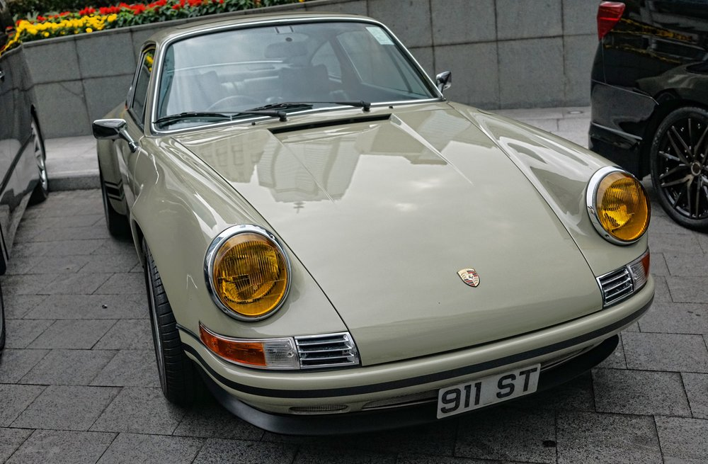 Only slightly less exotic.. this somewhat old fashioned Porsche 911 parked at the amazing Four Seasons Hotel.
