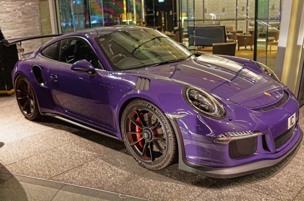 I am not a fan of purple but by golly it looks amazing on this Porsche GT3 RS....this one is parked up at the amazing Ritz Carlton Hotel in ICC.   Go here for all of my Porsche images taken in Hong Kong