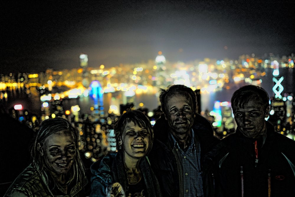 Meet the Christies... I was having one of those days and I took an image on top of the Peak Tower at around 9pm and it did not turn out as planned so I had no choice but to turn them into Zombies with somewhat interesting results. So from left to right - Julie, Joanne, David and Sam who were good sports!   Go here for all of my images of my guests in Hong Kong