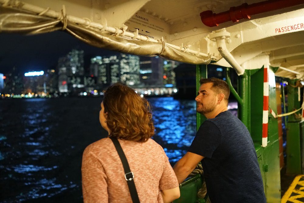 Hong Kong Night Tour -  Meet Travis and Michelle enjoying a night time ride on the iconic Star Ferry.... for some people it is the highlight of their Hong Kong visit, it really is a special experience.