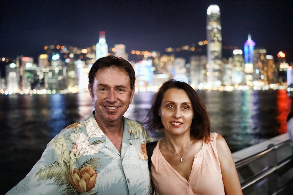 Hong Kong Night Tour - John and Tatyana enjoying the view from TST Promenade in Kowloon looking across Hong Kong Harbour to Hong Kong Island.