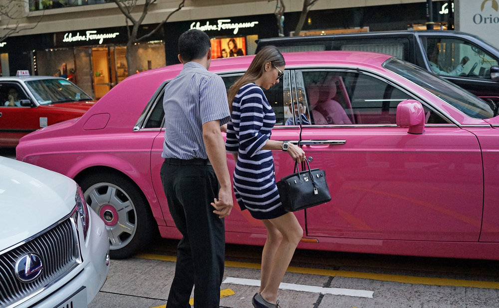 Hong Kong Airport Layover / Transit Tours -  Hong Kong has some pretty interesting rich folk, none more so than Deborah, this is Deborah, she travels around in her pink Rolls Royce Phantom and her 2 bodyguards, seems to do a lot of shopping!
