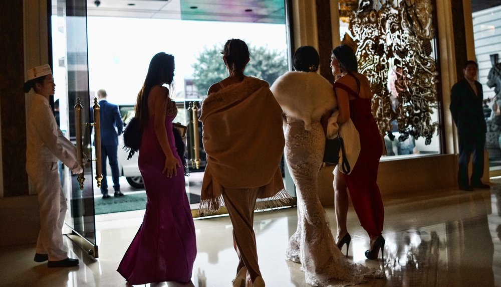 Oh my, I was lucky to get this shot of some awfully nice rich girls slinking their way through the magnificent and somewhat iconic Peninsula Hotel... WOW   Go here for all of my images of the Peninsula Hotel, Hong Kong.