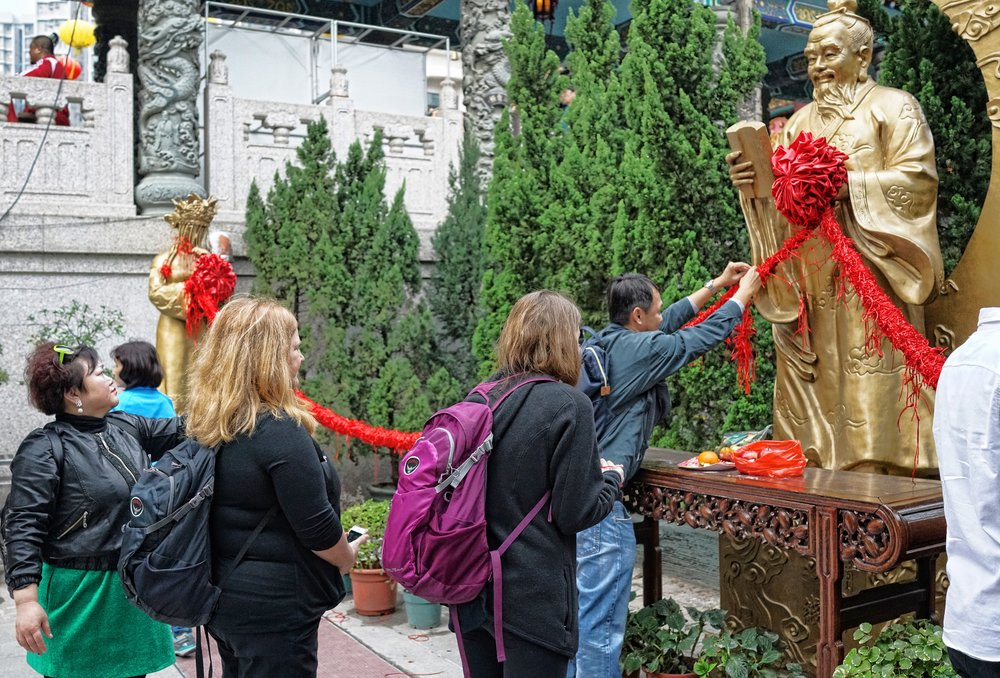 This is Miranda (the daughter) and Christine doing their thing in front of the God of Love and Marriage at the Sik Sik Yuen Wong Tai Sin Temple, just one of the many cultural things on offer when you do one of my private tours of Hong Kong.