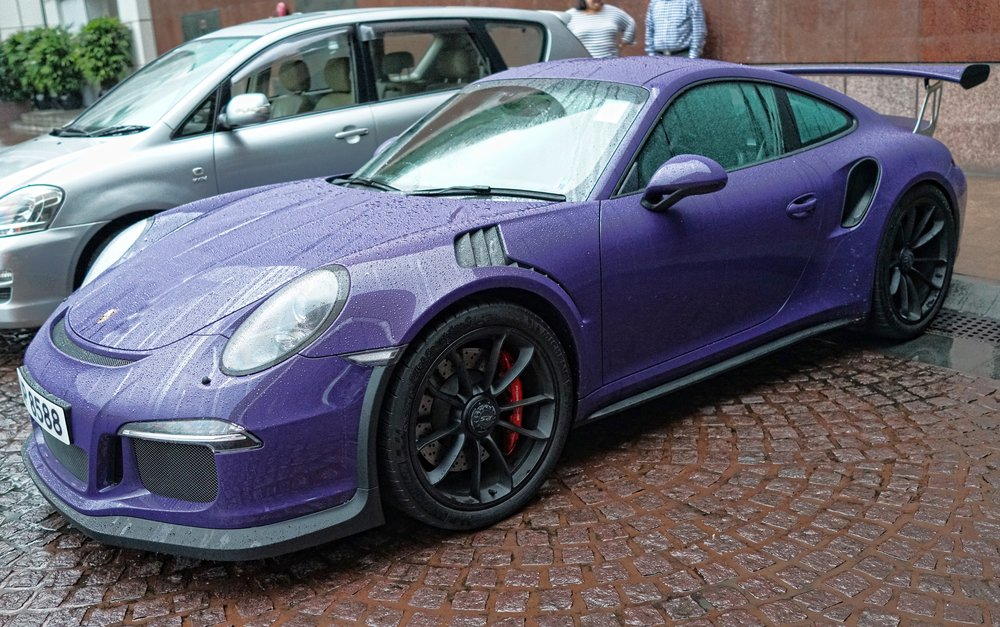 My favourite car, the Porsche GT3 RS, it is a beast.... they took out the back seats so that you get ultra performance... WOW.  So, I am not a fan of the purple colour above but it looks great in orange and red...   Go here for all of my images of Porsche Cars I have taken in Hong Kong.