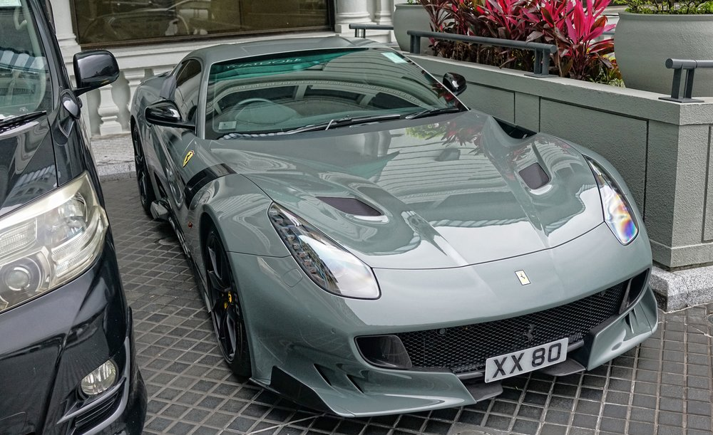 Holy moly, I believe this to be the Ferrari FF12 TDF a very rare and superfast Ferrari, I just love the colour as well.... as usual the Peninsula Hotel is one of the prime places to spot exotic cars and I try and pass by daily.