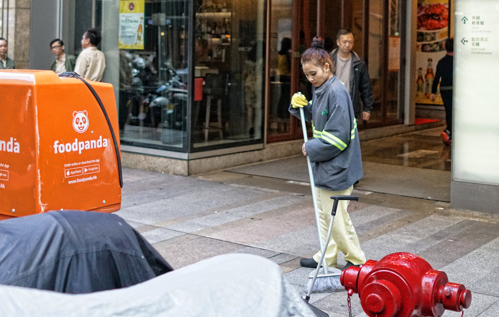 This young lady sweeping the Streets is Nepalese and is by far the most glamorous street sweeper I have ever seen in Hong Kong.