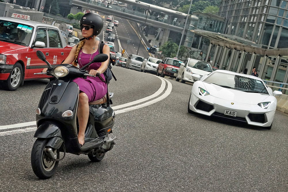 This is still one of my favourite images, scooter lady holding up the traffic and being chased by a Lamborghini!!
