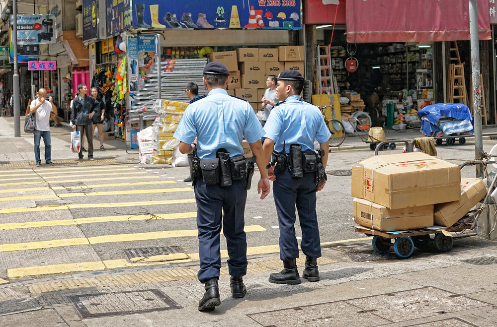 Special Police Unit, the PTU on patrol in deepest darkest Mong Kok.. it was stop and search day so they were stopping ladies of the night and dodgy looking blokes...   Go here for all of my images I have taken of the Hong Kong Police in action