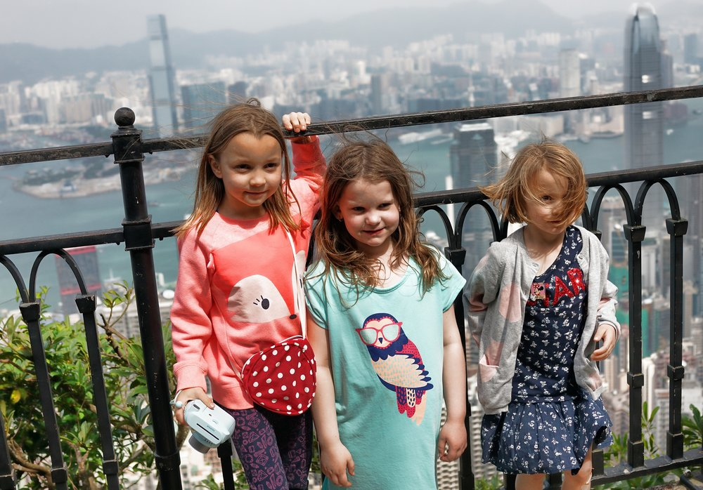 Kid Friendly Tours Hong Kong -  A pretty normal mix of kids on my tours! here they are enjoying the view at my spot at the Peak and they took a lot of their own images.... meet Taylor, Madeleine and Georgette