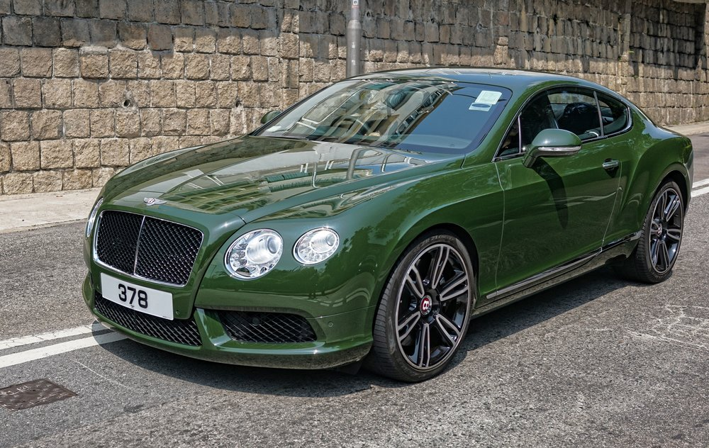 I like this lovely green Bentley almost as much as the red Bentley! it is a very striking car and it has quite a lucky number plate as well.