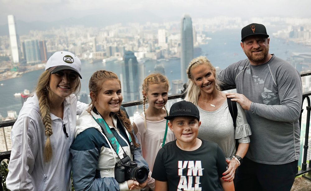 Kid Friendly Tours Hong Kong -  Another pretty normal mix of kids on my tours! here they are enjoying the view at my spot at the Peak and selfies were the order of the day.... meet Jen, Jared, Kennedy, Brooklyn, Cole and Bailey from Arizona.
